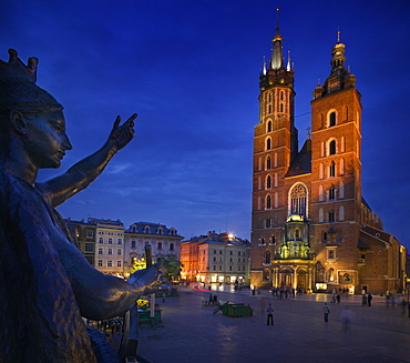 POLAND  Krakow St Marys Church in Rynek Glowny with part of the Adam Miekiewicz Memorial in the foreground. Tourism Travel Holidays Eastern Europe Sqaure