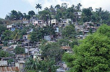 JAMAICA Montego Bay Norwood Overcrowded slum area  shanty housing on hillside with corrugated tin rooves.