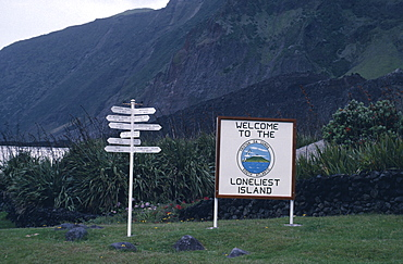 TRISTAN DA CUNHA  Communication Sign with Welcome to the Loneliest Island written on it next to a direction sign post Tristan da Cunha is a group of remote islands in the south Atlantic Ocean. It is a dependency of the British overseas territory of Saint Helena