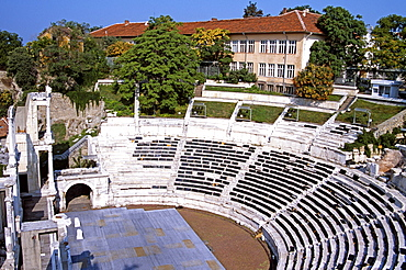 BULGARIA  Plovdiv Roman Amphitheatre. Travel Tourism Holiday Vacation Explore Recreation Leisure Sightseeing Tourist Attraction Tour Amphitheatre Amphitheater Plovdiv Bulgaria Bulgarian East Eastern Europe European History Historic Historical Architecture Architectural Building Summer Bright Sunny Sun Seating Forum Entertain Entertainment Semi-circle Tiers Roman Stadium Eastern Europe