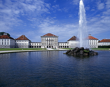 Nymphenberg Palace, Ornamental lake with rock fountain and tall water spout, Munich, Bavaria, Germany
