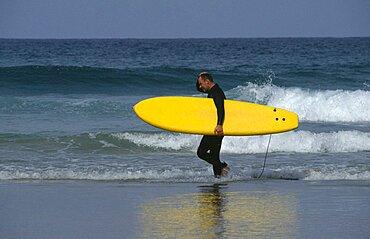 Surfer on Fistral Beach, Newquay, Cornwall, England, United Kingdom