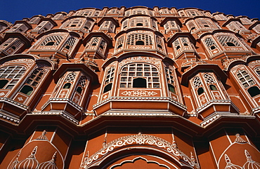 Hawa Mahal or Palace of the Winds, View looking up at the pink facade of the Rajput style architecture, Jaipur, Rajasthan, India