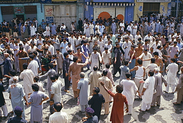 Mohurrum Festival, Men beating their chests durring Shia muslim festival of mourning to commemorate the death of Husayn ibn Ali grandson of Muhammad, Peshawar, Pakistan