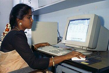 Young Indian woman using computer, Bangalore, Karnataka, India