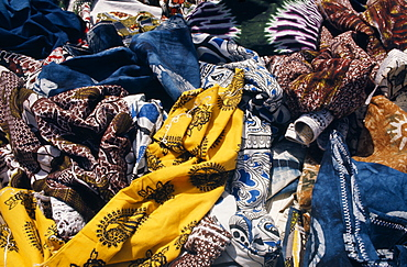 Local dyed and printed fabrics for sale in market, Dakar, Senegal, Africa