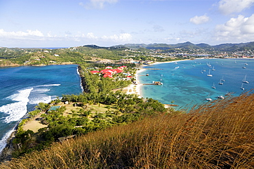 The isthmus leading to Pigeon Island seen from Signal Hill within the National Historic Park with the Atlantic Ocean on the left and the Caribbean of Rodney Bay on the right, Gros Islet, St Lucia
