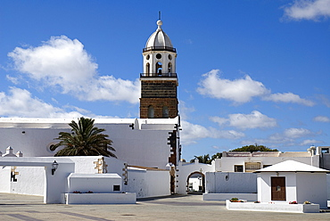 Teguise the former capital of the island, Church of Nuestra Senora de Guadalupe also known as Iglesia de San Miguel white painted exterior and bell tower, Lanzarote, Canary Islands, Spain