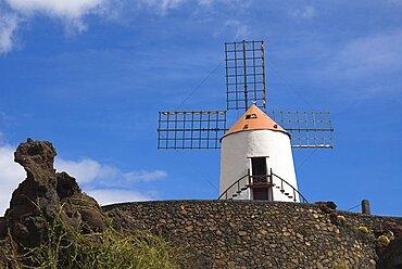 Jardin de Cactus, Restored windmill in garden in former volcanic quarry designed by Cesar Manrique, Lanzarote, Canary Islands, Spain
