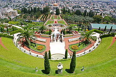 Zionism Avenue, View of Bahai Shrine and Gardens built as memorial to founders of the Bah ai faith, Formal layout of flowerbeds and pathways with cypress trees central domed shrine and city beyond, Haifa, Israel