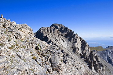View of highest peak of Mount Olympus called Mytikas, Eroded rocks and scree against blue cloudless sky, Pieria, Macedonia, Greece