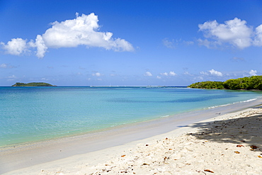 Waves breaking on Paradise Beach at LEsterre Bay with the turqoise sea and Sandy Island sand bar beyond, Caribbean