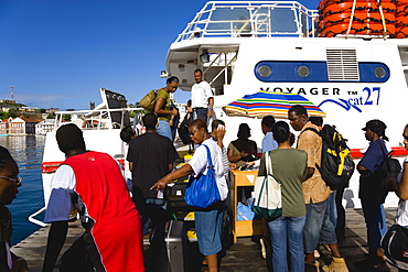 The Osprey Shuttle catamaran inter island service in the Carenage with passengers boarding in the morning for Carriacou and Petit Martinique, Caribbean