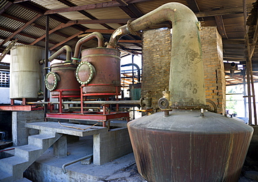 The wood fired copper stills at the River Antoine rum distillery, Caribbean