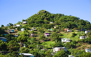 Houses built on stilts lining a hillside, Caribbean
