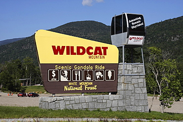 New Hampshire, USA, Wildcat Mountain ski area, Sign advertising scenic gondola cable car rides.