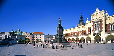 POLAND  Krakow  View across Rynek Glowny or Grand Square and the sixteenth century Renaissance Cloth Hall covered market.