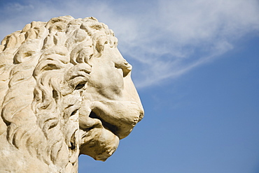 Italy, Veneto, Venice, Centro Storico, Arsenale, Head of guardian lion of free Venice statue against blue sky of late summer