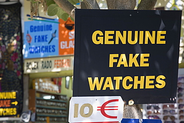 Turkey, Izmir Province, Selcuk, Ephesus, Sign advertising Genuine Fake Watches and ten Euro price ticket