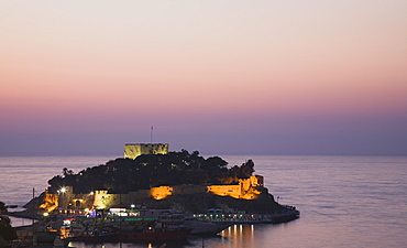 Turkey, Aydin Province, Kusadasi, Sunset over Guvercin Ada, the peninsula of Kusadasi, also known as Pigeon Island