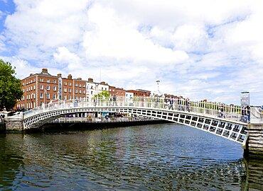 Ireland, County Dublin, Dublin City, The 1816 cast iron Ha Penny or Half Penny Bridge across the River Liffey.