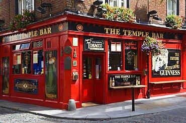 Ireland, County Dublin, Dublin City, Temple Bar traditional Irish public house on street corner with cobbled street.