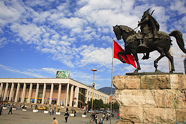Albania, Tirane, Tirana, Equestrian statue of national hero George Castriot Skanderbeg in busy Skanderbeg Square with the Opera House in the background.