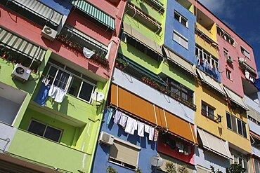 Albania, Tirane, Tirana, Angled part view of exterior facade of multi coloured apartment block.