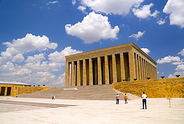 Turkey, Ankara, Anitkabir, Mausoleum of Mustafa Kemal Ataturk the founder of the Turkish Republic and president in 1923 who died in 1938. Monumental rectangular structure set on hilltop with flight of steps to colonnaded entrance. Visitors in middle foreground.