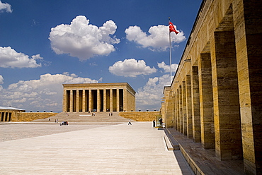 Turkey, Ankara, Anitkabir, Mausoleum of Mustafa Kemal Ataturk founder of the modern Turkish Republic and president in 1923. Monumental structure set on hilltop with flight of steps to colonnaded entrance and bordered by further colonnades flying Turkish flag.