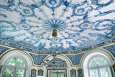 Germany, Bavaria, Munich, Nymphenburg Palace the Pagodenburg. Interior of elegant pavilion for royal relaxation with over 2000 blue and white painted Dutch tiles decorating the walls and ceiling.
