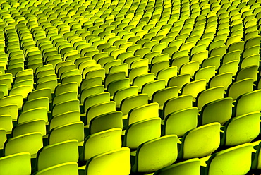 Germany, Bavaria, Munich, Olympic Stadium. Curved section of bright green seating in the stadium.