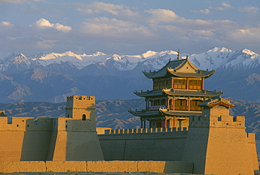 CHINA Gansu Jiayuguan The fortress at the western end of the Great Wall with snow capped mountains behind  Silk Road Route