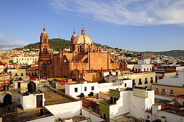 View across flat rooftops of houses towards Cathedral, Zacatecas, Bajio, Mexico