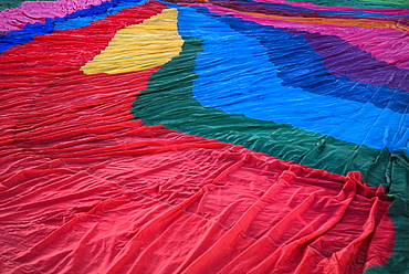 Annual balloon fiesta Detail of colourful hot air balloon spread over ground before inflating, Albuquerque, New Mexico, United States of America