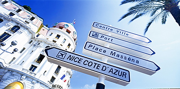 FRANCE Provence-Cote d Azur Nice Promenade des Anglais.  Angled view of directional road sign in front of the Hotel Negresco  partly seen behind.  Alpes Maritimes