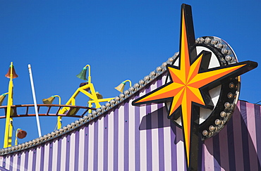 England, Lincolnshire, Skegness, Facade of amusement arcade in clear blue sky.