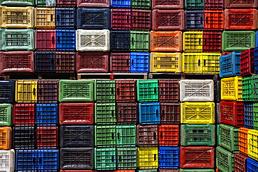 Greece, Makedonia, Verioa, geometrical colorful plastic crates forming a pattern.