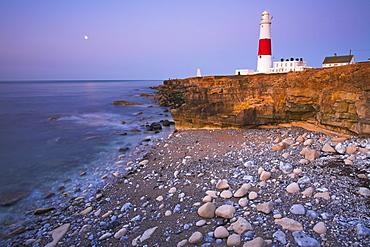 The moon glows over the sea at Portland Bill, Jurassic Coast, UNESCO World Heritage Site, Dorset, England, United Kingdom, Europe