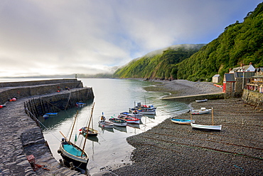 Fishing boats moored in the harbour at Clovelly, Devon, England, United Kingdom, Europe