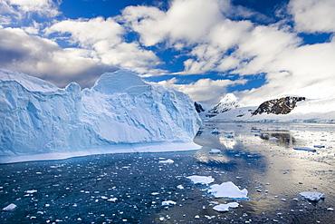 Icebergs, brash ice and mountainous terrain on the Gerlache Strait, Antarctic Peninsula, Antarctica, Polar Regions