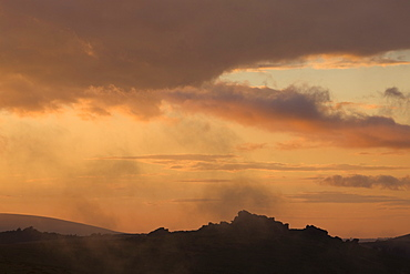 Silhouetted Hound Tor at sunset, Dartmoor National Park, Devon, England, United Kingdom, Europe
