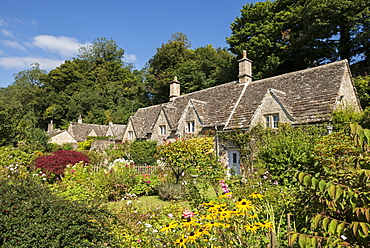 Pretty country cottages and gardens in the picturesque Cotswolds village of Bibury, Gloucestershire, England, United Kingdom, Europe