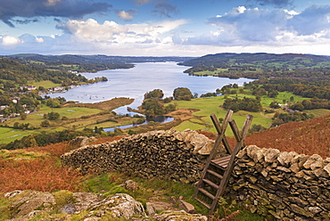 Drystone wall and stile with views to Windermere in autumn, Lake District National Park, Cumbria, England, United Kingdom, Europe