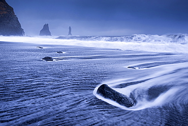 Waves rushing over black sand beach near Vik on the South coast of Iceland, Polar Regions