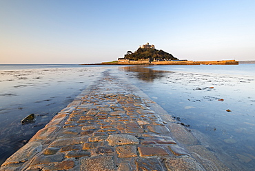 The stone causeway leading to St. Michaels Mount in early morning sunshine, Marazion, Cornwall, England, United Kingdom, Europe