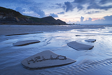 A welcome message left in the sand on Crackington Haven Beach, Cornwall, England, United Kingdom, Europe