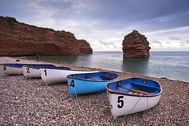 Boats pulled up on the shingle at Ladram Bay on the Jurassic Coast, UNESCO World Heritage Site, Devon, England, United Kingdom, Europe