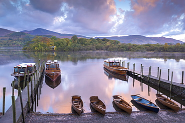 Boats moored on Derwent Water at dawn in autumn, Keswick, Lake District, Cumbria, England, United Kingdom, Europe