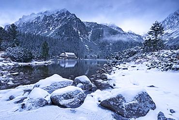 Popradske Pleso lake and mountain cottage in wintertime, Slovakia, Europe